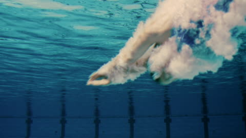 female swimmer jumping into pool - swimming goggles stock videos & royalty-free footage