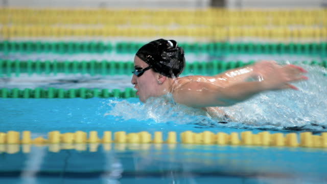 SLO MO TS Female swimmer swimming butterfly style