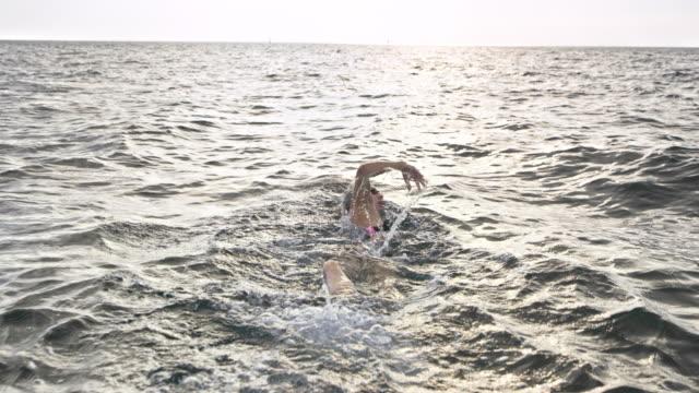 SLO MO Female swimmer swimming forward crawl in the ocean