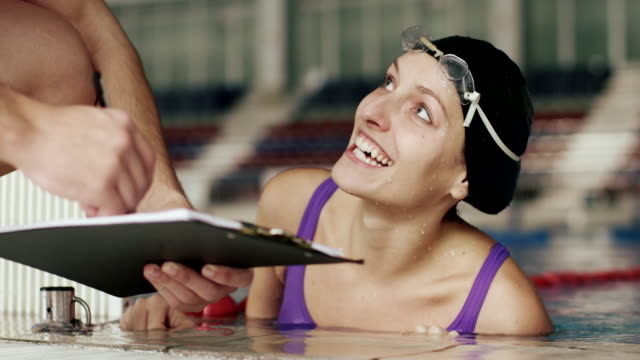 Female swimmer with coach