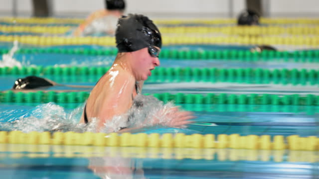 TS Female swimmers competing in breaststroke style