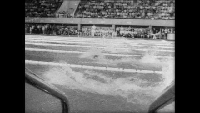 female swimmers in 100 meter backstroke race in winnipeg, canada / elaine tanner of canada wins. - backstroke stock videos & royalty-free footage