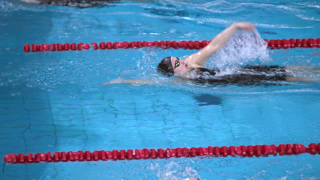 slo mo ts female swimmers in backstroke making a turn - backstroke stock videos & royalty-free footage