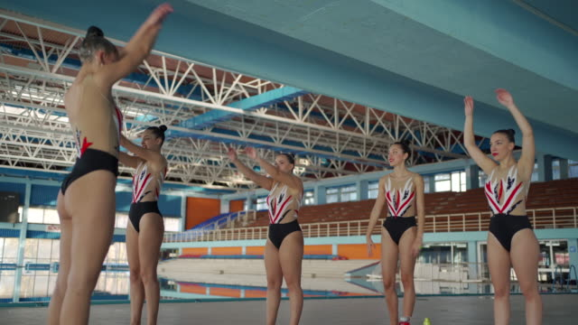 female  swimmers stretching together - woman swimming costume stock videos & royalty-free footage