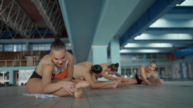female synchronized swimmers stretching near poolside - woman swimming costume stock videos & royalty-free footage
