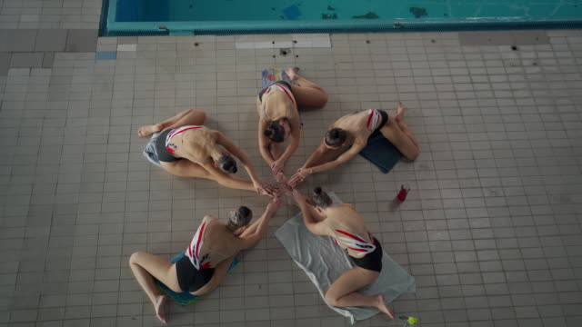 female synchronized swimmers stretching together - woman swimming costume stock videos & royalty-free footage