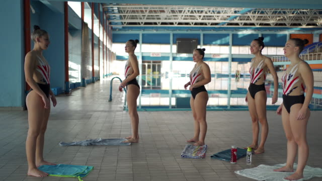 female synchronized swimmers stretching - woman swimming costume stock videos & royalty-free footage