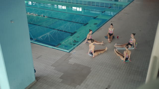 female synchronized swimmers warming up before training - woman swimming costume stock videos & royalty-free footage