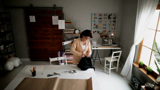 Female Tailor At Work With Chalk