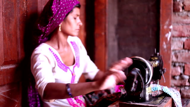 female tailor, sewing clothes at home using sewing machine - manufacturing machinery stock videos & royalty-free footage