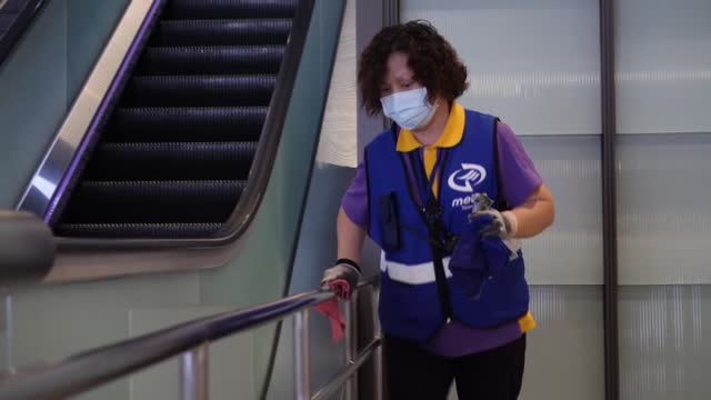 female taiwanese worker cleans and disinfects a nearly empty subway station at taiwan taoyuan international airport during the lockdown because of... - taipei stock videos & royalty-free footage