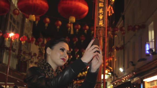 female taking picture of herself in chinatown - chinatown stock videos & royalty-free footage