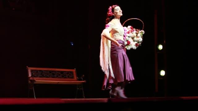 a female tango dancer and singer during the tango show tango porteno in buenos aires argentina - tango ballo video stock e b–roll