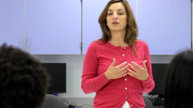 Female Teacher Interacting with Group of Students