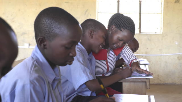 female teacher with school children. kenya, africa. - supported stock videos & royalty-free footage