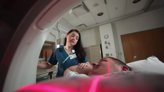 ms female technician assisting patient undergoing computed tomography / portland, maine, usa - males stock videos & royalty-free footage