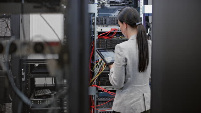 ds female technician working in the server room - network server stock videos & royalty-free footage