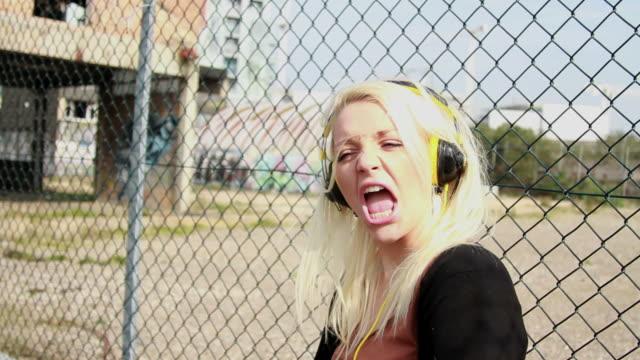 female teenager dancing with headphones - blonde hair stock videos & royalty-free footage