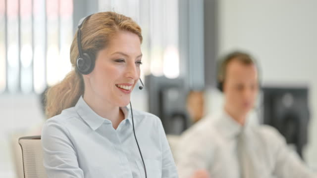 PAN Female telephone operator talking to a client