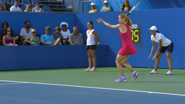 Female Tennis Player Hitting A Ball