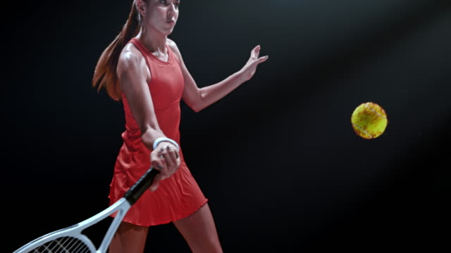 slo mo ds female tennis player hitting a wet ball - tennis stock videos & royalty-free footage