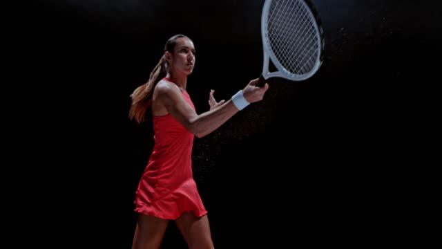 slo mo female tennis player hitting the ball - forza video stock e b–roll