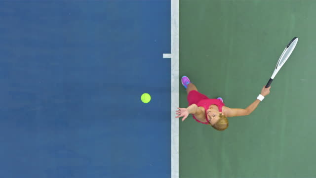 female tennis player serving the ball - tennis ball stock videos & royalty-free footage