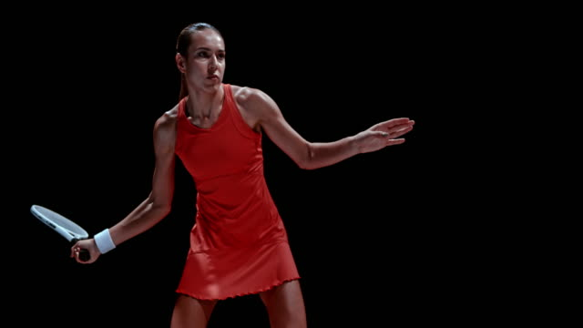 slo mo ds female tennis player striking the ball - hitting stock videos & royalty-free footage