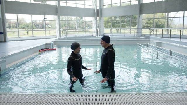female therapist explaining how hydrotherapy works to mature male patient - hydrotherapy stock videos & royalty-free footage