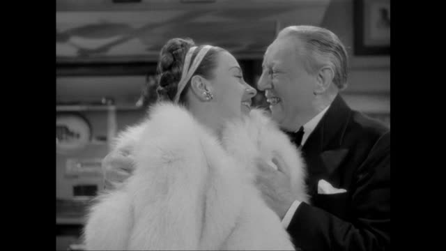 1946 female thief (patricia morison) shouts at murdering accomplice after he stabs music box collector - knife crime stock videos & royalty-free footage