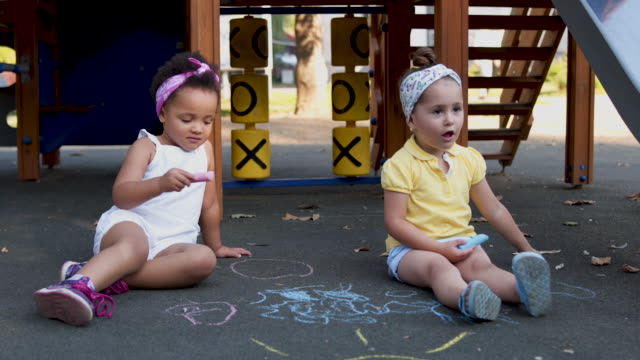 female toddlers playing together with chalk - preschool child stock videos & royalty-free footage