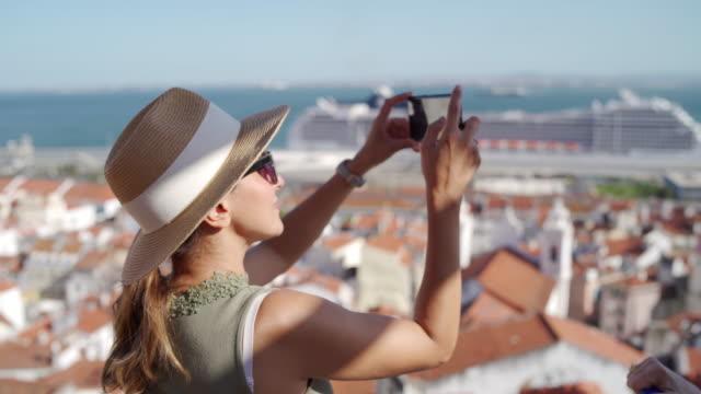female tourist taking photo of lisbon - portugal stock videos & royalty-free footage