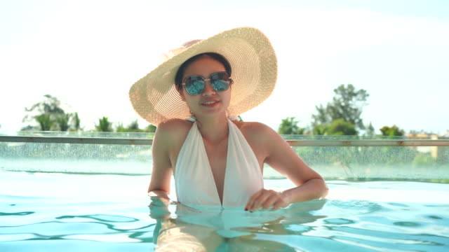 female tourists stay in pool villa rooms - standing water stock videos & royalty-free footage