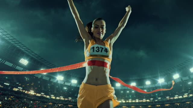 female track and field runner crosses finishing line - finishing stock videos and b-roll footage