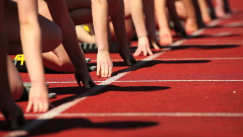 female track runners at starting line - track and field stock videos & royalty-free footage
