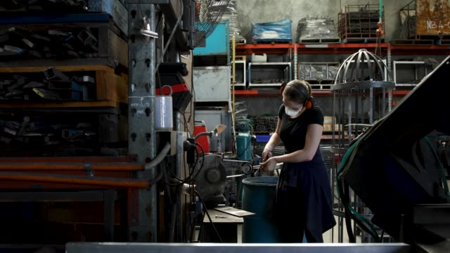 female tradesperson using power tool in factory - work tool stock videos & royalty-free footage