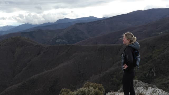 female trail runner ascends mountain ridge - jacket stock videos and b-roll footage