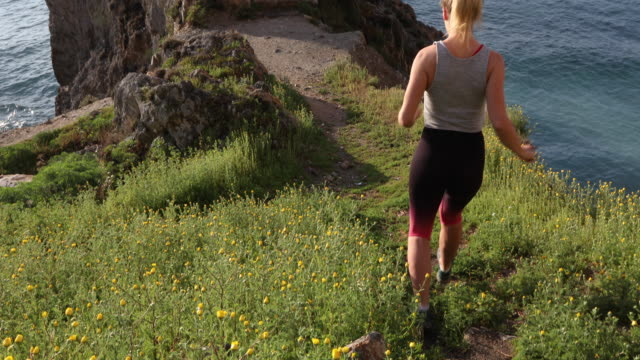 female trail runner ascends stone staircase - steps and staircases stock videos & royalty-free footage