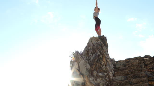 female trail runner ascends stone staircase - pedal pushers stock videos & royalty-free footage