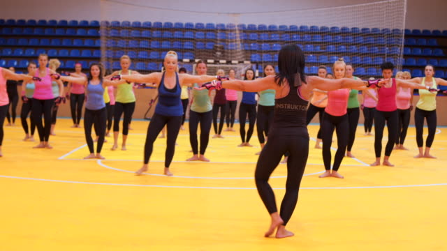 female trainer shows exercise - aerobics stock videos & royalty-free footage