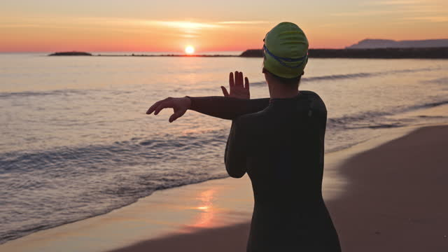 "female triathlete preparing for swimming workout at dawn - xavierarnau or ""xavier arnau serrat"" stock videos & royalty-free footage"