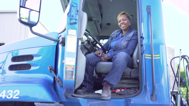 female truck driver inside the cab of her truck - females stock videos & royalty-free footage