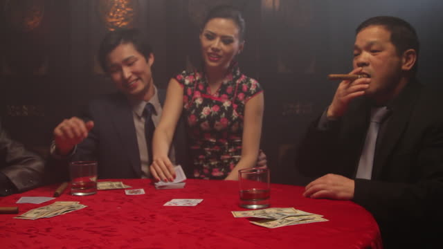 female turning over winning card in black jack game - organized crime stock videos and b-roll footage