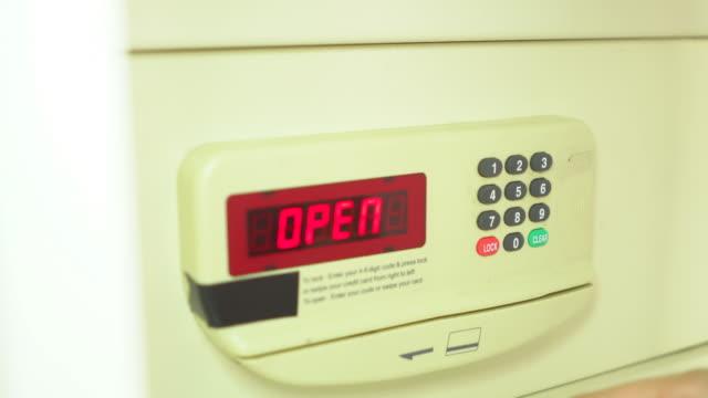 Female unlocking the safe