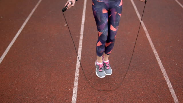 female using jump rope on sports track - jump rope stock videos and b-roll footage