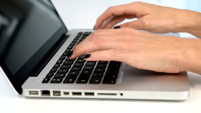 Female using keyboard computer