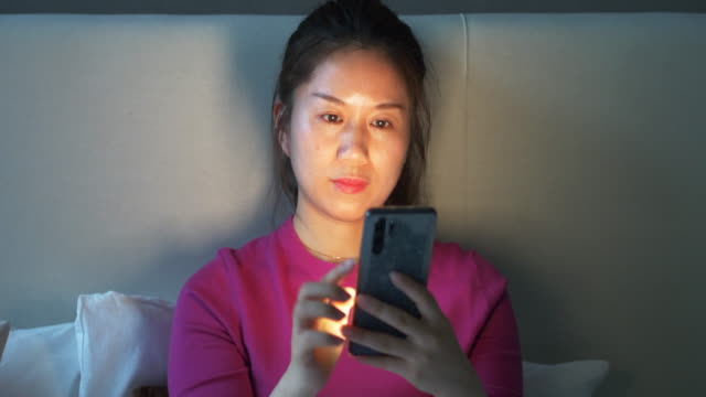 female using smart phone on bed - stereotypical homemaker stock videos & royalty-free footage