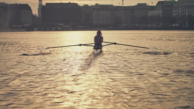 female using smart watch while rowing in river - sculling stock videos & royalty-free footage