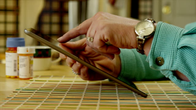female using tablet - prescription medicine bottles stock videos & royalty-free footage