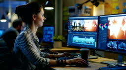 Female Videographer Edits and Cuts Footage and Sound on Her Personal Computer. Her Office is Modern and Creative Loft Studio.